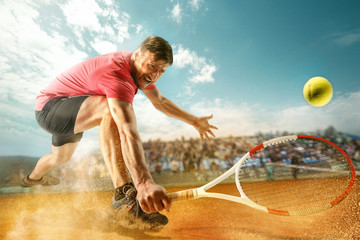 Fototapeta The one jumping player, caucasian fit man, playing tennis on the earthen court with spectators