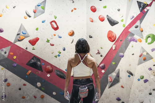Unrecognizable woman ready for practice rock climbing on artificial wall indoors Canvas Print