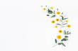 Leinwandbild Motiv Flowers composition. Pattern made of yellow flowers and eucalyptus leaves on white background. Flat lay, top view, copy space