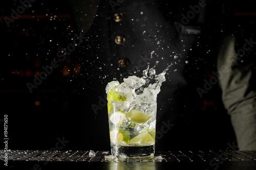 Canvas Prints Cocktail Glass filled with splashing fresh Caipirinha cocktail