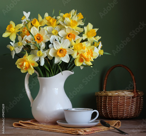 yellow daffodils in a white jug