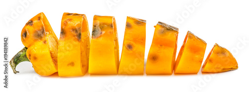 Fototapeta  Chopped rotten yellow bell pepper isolated