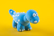 Camarasaurus. Play dough figure on yellow background