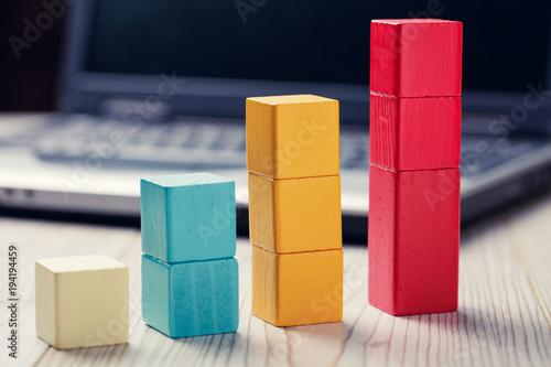 Fotografía  building blocks cubes against blur laptop background