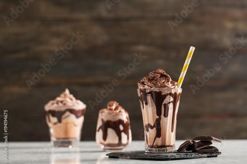 Fotobehang Milkshake Chocolate Milk and Whipped Cream on Wooden Background