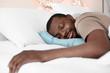 African American man sleeping in bed