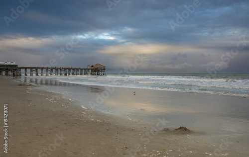 In de dag Inspirerende boodschap storm clouds moving in on the pier at blue hour