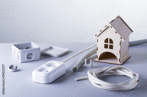 Electric equipment for apartment repair on a grey background