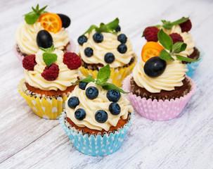 Fototapeta Cupcakes with fresh berries