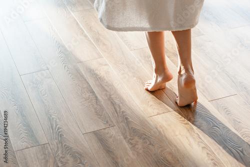 Cuadros en Lienzo Closeup shot of female feet under bed at morning