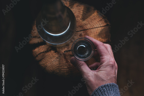 Man drinking strong alcohol drink Fototapeta
