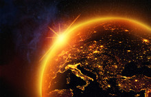 Vision Of The Earth In Outer Space,the Light Of The Rising Sun Floods Europe With A Golden Glow