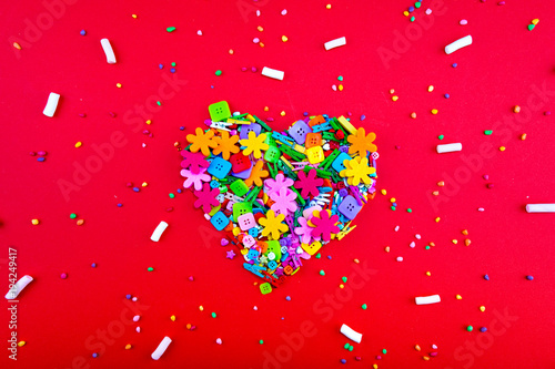 Colorful confetti candy and sweet marshmallow the form of heart