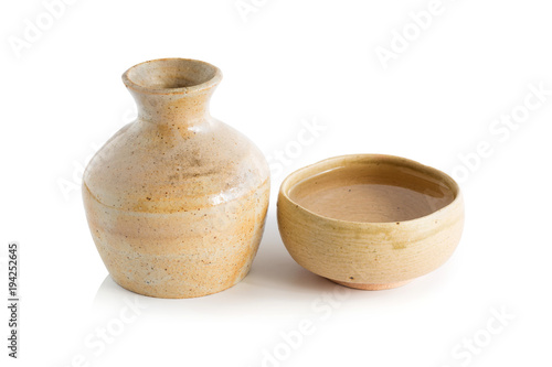 Japanese Sake drinking in ceramic jars and ceramic glass isolated on a white background