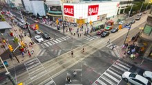 Toronto, Ontario, Canada, Time Lapse View Of People And Traffic Crossing Busy Intersection At Yonge-Dundas Square.