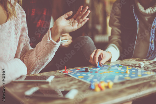 Obraz Three girls playing game man do not angry. Close up. - fototapety do salonu