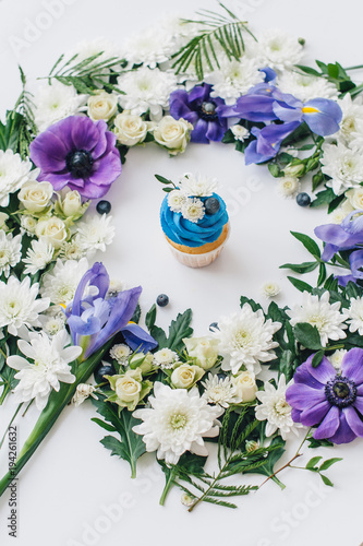 Garden Poster spring cupcake on a white background with flowers and fruits aro