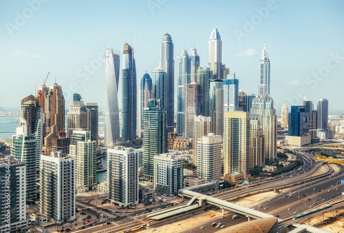 Foto op Plexiglas Midden Oosten Scenic panoramic view of modern city architecture. Aerial daytime skyline of Dubai Marina, UAE, with skyscrapers and highways. Summer travel background.