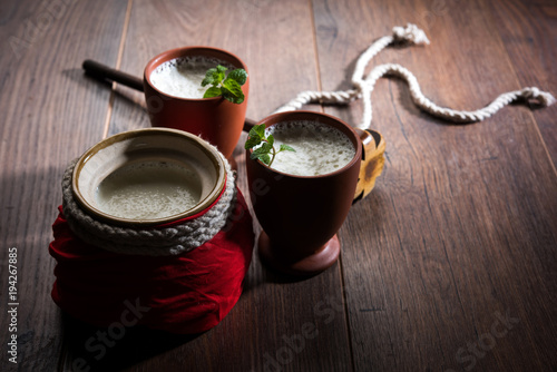 Fotografía Lassie or lassi in terracotta glass - Lassi is an Authentic Indian cold drink ma