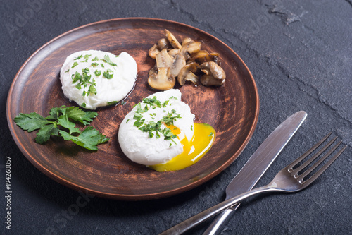 Poached eggs with parsley and mushrooms