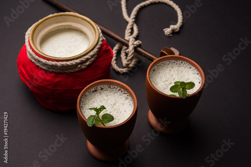 Fényképezés  Lassie or lassi in terracotta glass - Lassi is an Authentic Indian cold drink ma