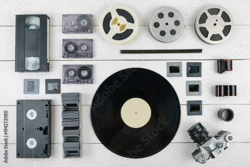 Creative Flat Lay of old vintage information medium of 90s on white wooden background Fototapete