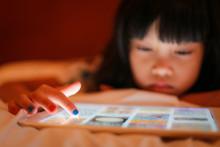 Kid Finger Tip Touch On Digital Tablet Device.