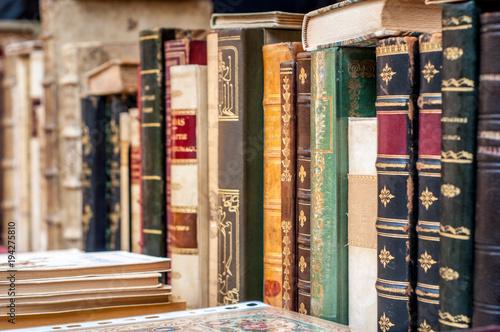 Deurstickers Illustratie Parijs Old books background. Books in a row.