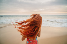 Young Red-haired Woman With Fl...