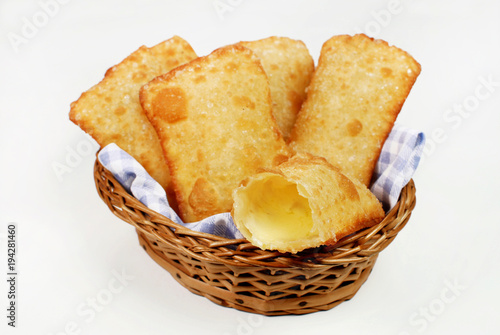 Brazilian typical pastry called pastel in white background with one of cheese open