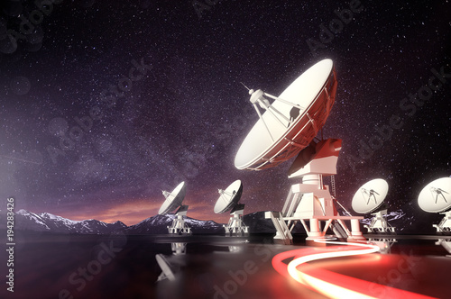 Photo Radio telescopes searching for astronomical objects at night