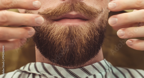Fotomural Closeup of a cropped photo of a bearded stylish men