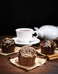 chocolate muffin sprinkled with nuts