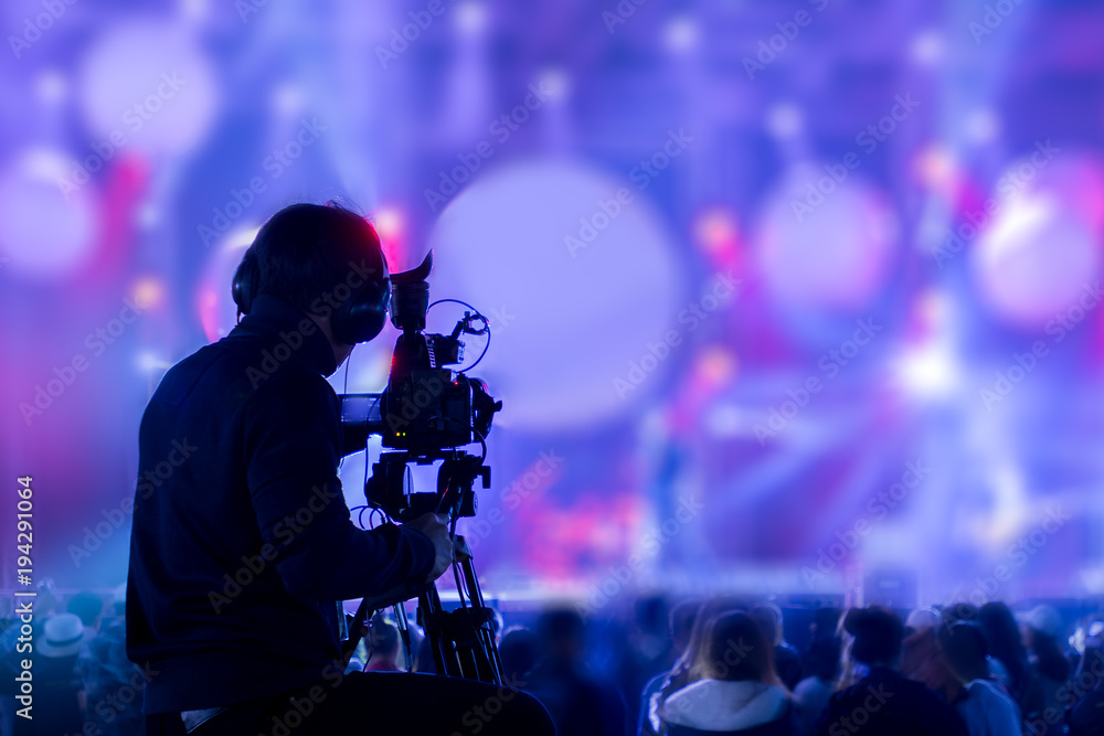 Fototapeta The filmmaker is recording and broadcasting live concerts on camcorders. Professional Video Recording Business