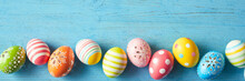 Border Of Colorful Decorated Easter Eggs On Blue