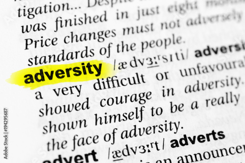 Photo Highlighted English word adversity and its definition in the dictionary
