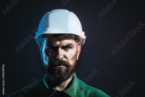 Portrait of mechanical worker. Industrial worker. Man builder. Architect, worker, engineer - work. Copy space for yours advertise.