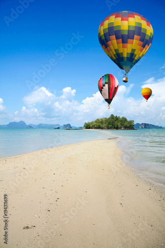 Colorful hot air balloon fly over the sea.