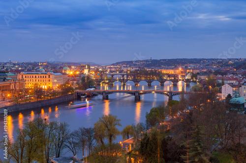 Garden Poster Napels Old town and bridges over Vltava river illuminated night view from Letenske garden. Prague, Czech Republic