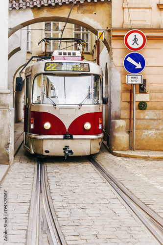 old red tram in the old streets of Prague Canvas Print