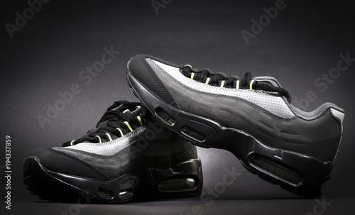 Fotografija  shoes on black background