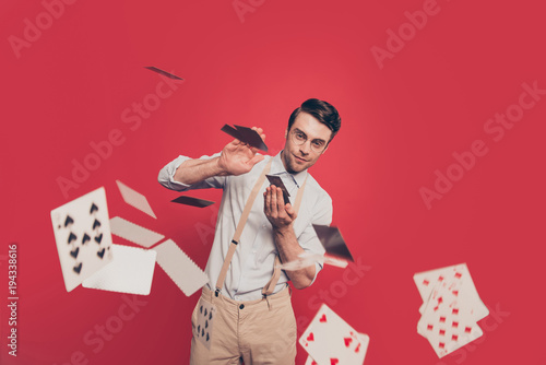 Fotomural Professional, cunning magician, illusionist, gambler in casual outfit, glasses,