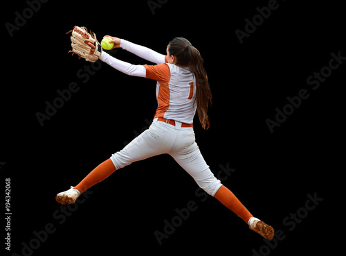 Fotografie, Obraz  Fast Pitch Softball Pitcher Throwing For a Strike