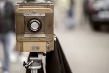 Vintage Photo Wooden Camera On Tripod. Processed With Retro Style. Photo, Cinema Concept And Other Antiquities. For Background , Backdrop With Copy Space
