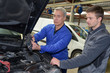auto mechanic teacher and trainee performing tests at mechanic school