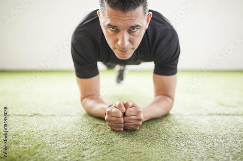 Fotografie, Obraz  man training on artificial grass