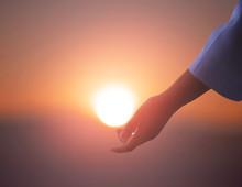 Sun On Female Hand. Silhouette Of Hand Holding Sun