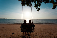 Couple In Love On A Swing Unde...
