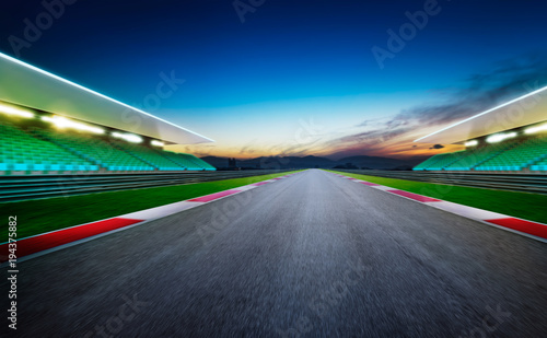 Poster F1 View of the infinity empty asphalt international race track .Night scene .