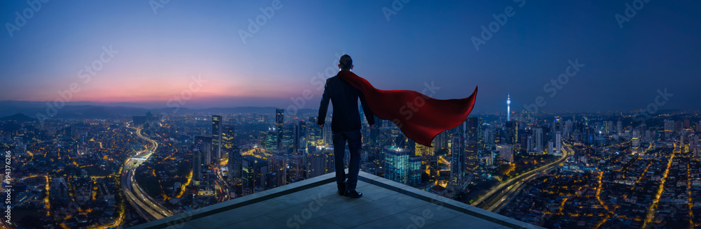 Fototapety, obrazy: Businessman in suit and cape hero stand at rooftop looking great cityscape view and thinking business plan of the future . Night scene .